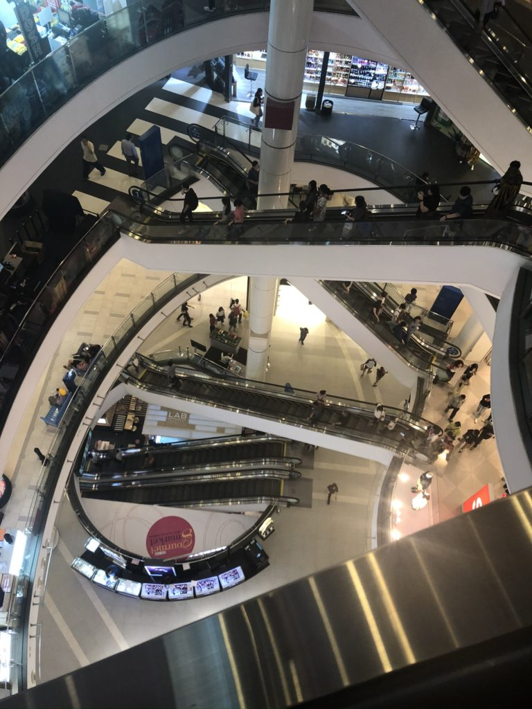 A picture of Terminal 21, looking down on rows of escalators