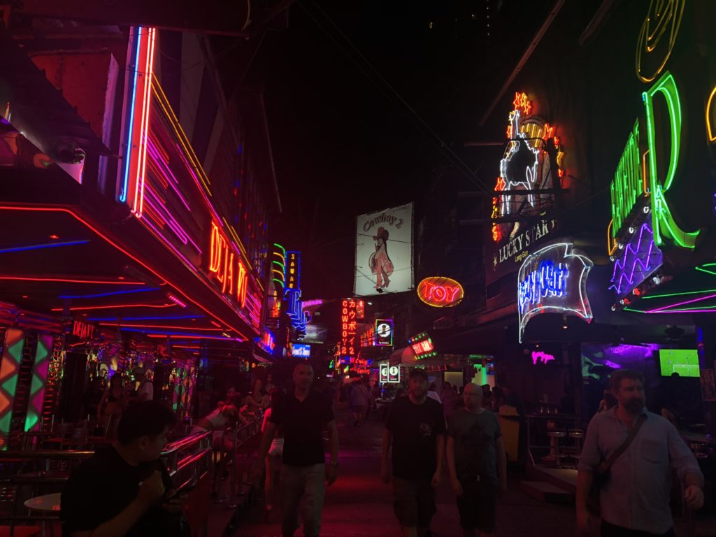 Picture of Soi Cowboy street at night — neon lights, tourists