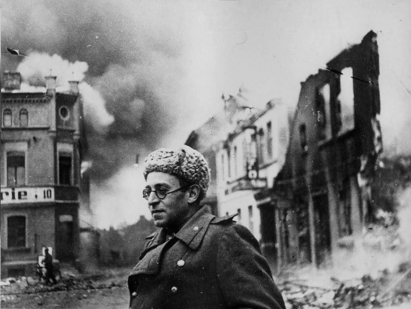 Image of Vasily Grossman, author Life and Fate, standing by a crumbling building in 1945 (black & white)