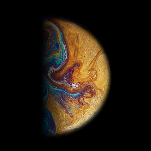 Image of a planet, half eclipsed